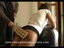 Her bottom is being paddled - she will never steal again