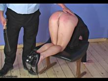 Spanking her sore bare bottom